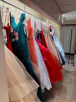 Racks of gowns at Linde's Bridal and Prom store in Massillon. Area school districts are deciding now whether to host proms or cancel due to COVID.