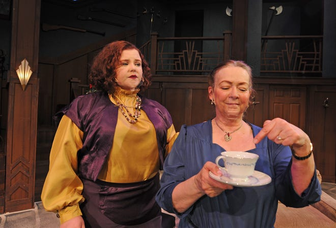 """Dalana Dutton, left, as Daria Chase, and Pam Jones, as Martha Gillette, act out a scene in which the cup of coffee is believed to have been poisoned in the upcoming mystery """"The Game's Afoot"""" that will be showing at the Salina Community Theatre starting on Friday, Feb. 19."""