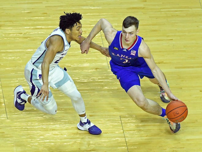 Kansas guard Christian Braun drives against Kansas State's Nijel Pack during the first half on Wednesday night's Sunflower Showdown game at Bramlage Coliseum.
