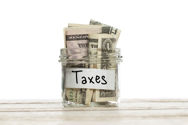 An escrow account holds money owed for expenses like mortgage insurance premiums and property taxes.