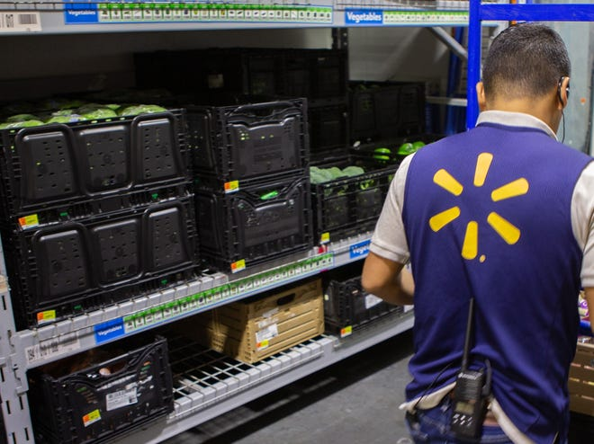Walmart is raising wages for 425,000 of its 1.5 million U.S. workers but reported a mixed performance on Thursday for the fourth quarter.