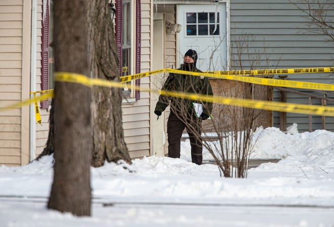 A Sangamon County sheriff's deputy walks through the scene of a shooting in 2200 block of East Enterprise Street in Grandview on Feb. 18. [Justin L. Fowler/The State Journal-Register]