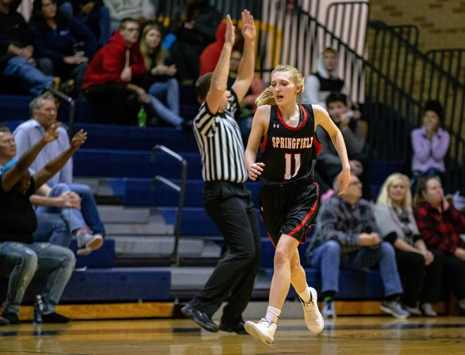 Springfield's Kenzey Decker reacts after hitting a 3-pointer against Sacred Heart-Griffin during the 2020 Girls City Tournament at Herb Scheffler Gymnasium. On Wednesday, Decker passed the 1,000-point mark in her career. [Justin L. Fowler/The State Journal-Register]