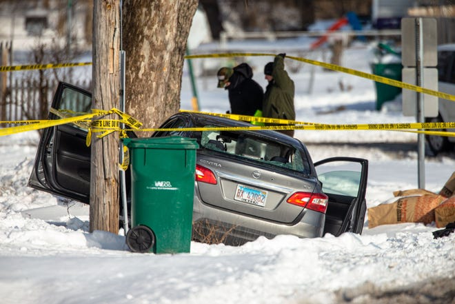 A car sits in the ditch with a rear window shot out as law enforcement begin investigating a shooting in 2200 block of East Enterprise Street in Grandview, Ill., Thursday, February 18, 2021. [Justin L. Fowler/The State Journal-Register]