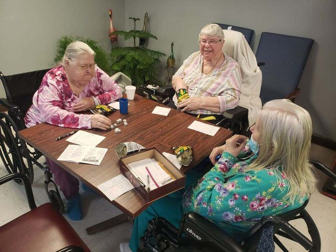 Residents at McLoud Nursing Center got through the winter storm by playing games and enjoying each other's company.