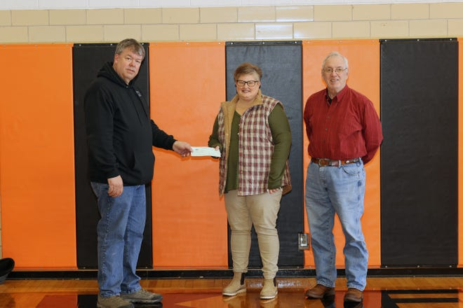 The family of the late Dean R. Peach recently made a $1000 donation to the  Kewanee Schools Foundation in support of the school's golf program. Mr. Peach was an avid golfer and enjoyed golfing every day that the course was open; he played in many of the local tournaments. Mr. Peach passed away Thursday, January 14, 2021. In the photo, Peach's sons, Sam Peach and CG Fifield, present the check to Kewanee Golf Coach Kandy Hansen. Additionally, the family of May Watson donated a set of golf clubs for Kewanee golf athletes.