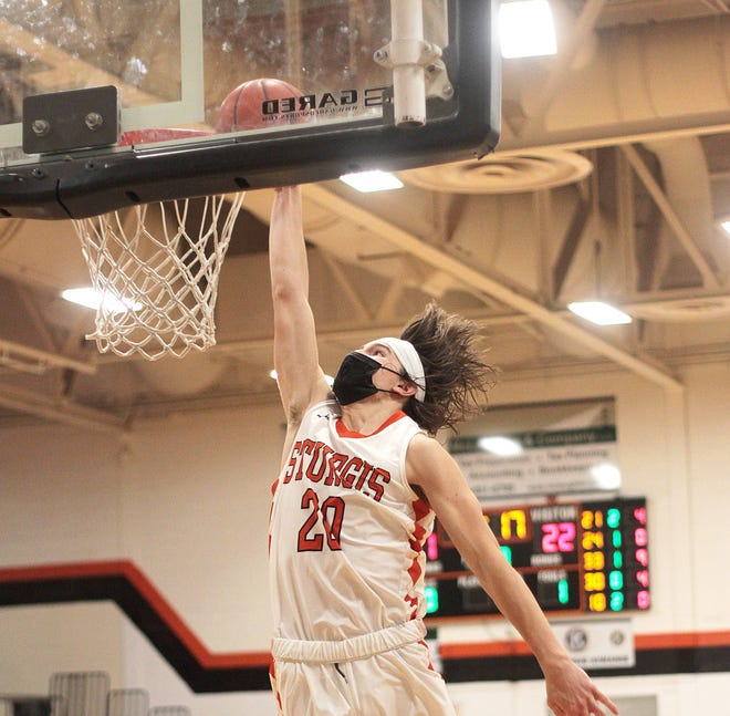 Thomas Kurowski throws down a dunk against Plainwell in Wednesday's win, where he led the Trojans with 31 points.