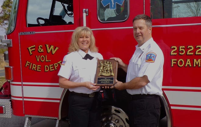At the end of every year the members of the Florence-Whortonsville Volunteer Fire Department select a member who they feel has made significant contributions to the organization. This year they selected Janet Porter. In this picture the new chief, Gary Mitchelson congratulates Janet on her recent award. [CONTRIBUTED PHOTO]