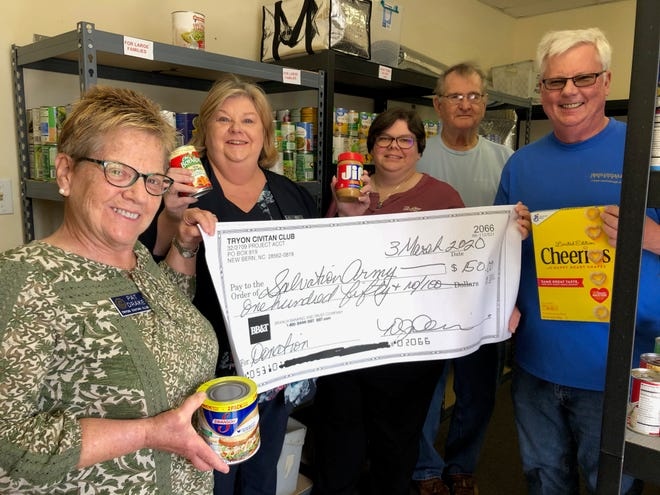 The Tryon Civitan Club delivered 630 lbs of food last February during their 10th Annual Salvation Army Food Drive. They also presented them with a check for $150. Pictured left to right are Tryon Civitans Pat Drake, Club President Angela Okell-Watson, Salvation Army Officer Sara Kratz, along with Tryon Civitans Rich Meyer and Mack Paul. [CONTRIBUTED PHOTO]