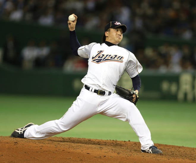 Japan's Hirokazu Sawamura pitches against the Netherlands in the 2013 World Baseball Classic in Tokyo.