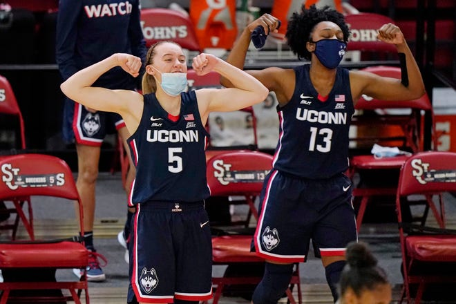 Connecticut guards Paige Bueckers (5) and Christyn Williams (13) react from the bench during the fourth quarter of the team's NCAA college basketball gam against St. John's, Wednesday, Feb. 17, 2021, in New York.