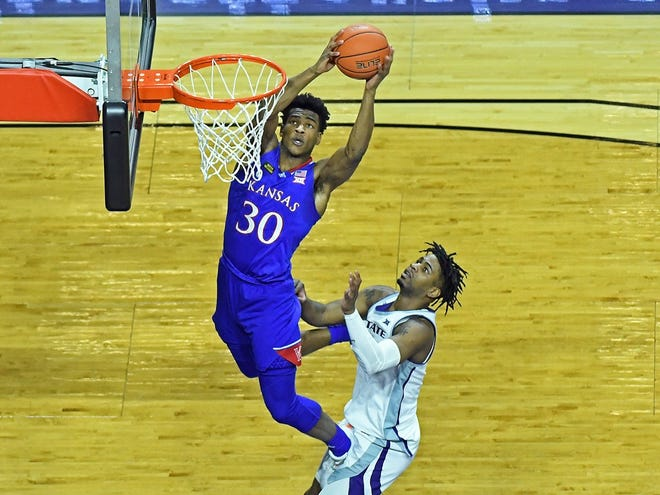Kansas junior guard Ochai Agbaji looks to score as Kansas State's Selton Miguel defends during Wednesday's game at Bramlage Coliseum in Manhattan. The No. 23-ranked Jayhawks won 59-41.