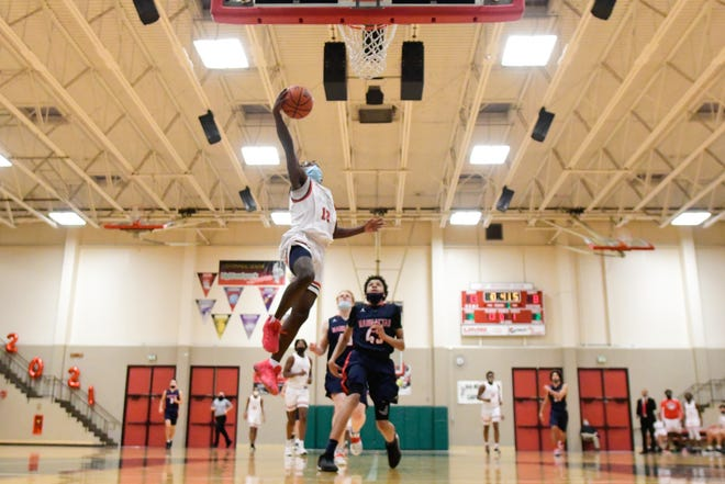 Highland Park senior Terahn Simms lays it in for two in the first quarter of Wednesday's senior night game against Manhattan.