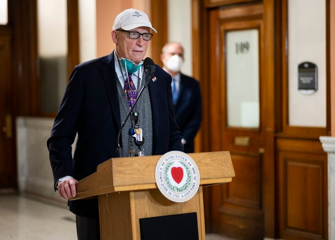 Dr. Michael Hirsh wears a 'keep calm and public health on' hat during the city's weekly COVID-19 press conference Thursday.