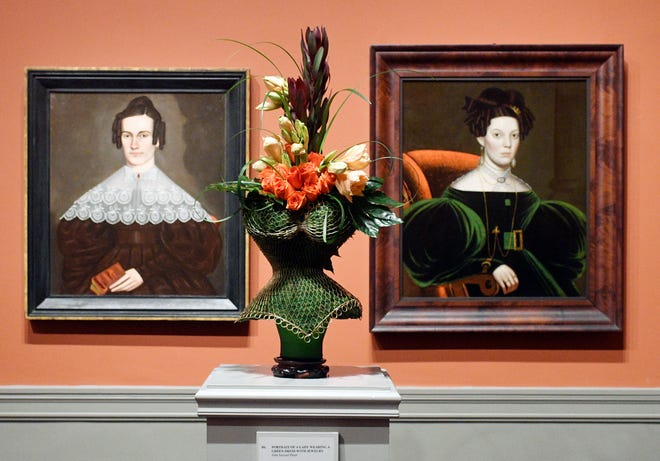 "Julie Lapham and Sarah Ribeiro of the Worcester Garden Club created the floral interpretation of John Samuel Blunt's ""Portrait of a Lady Wearing a Green Dress"" for the 2017 ""Flora in Winter"" exhibit at Worcester Art Museum. This year's ""Flora in Winter"" will be presented virtually."