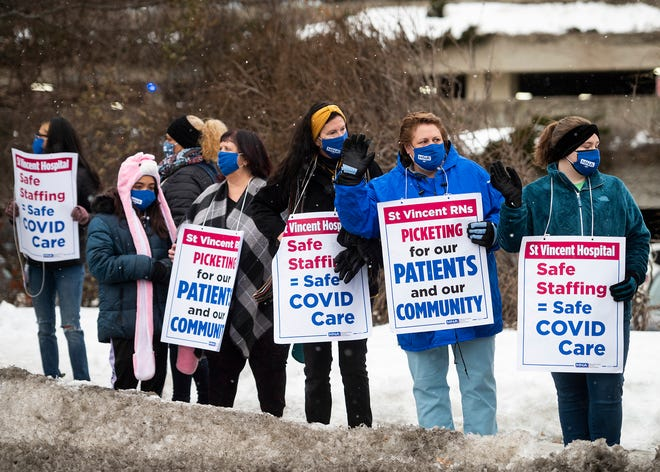 Nurses from St. Vincent Hospital picket outside the hospital last week.