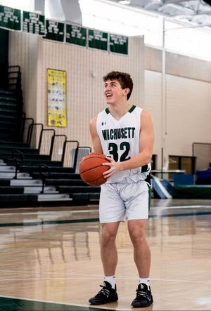 Wachusett Regional senior Luke Grady is socially distanced while his photo is taken for a poster that will hang in the gym Saturday on Senior Night.