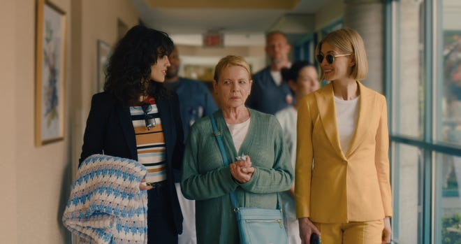 "From left, Eiza Gonzalez, Dianne Wiest and Rosamund Pike star in, ""I Care A Lot."""