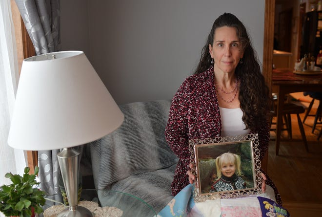 Kimberly Amato, founder of Meghan's Hope on Thursday,  with a picture of her daughter. Over her lap is a quilt made by a friend from Meghan's clothing. Amato hopes the STURDY Act which will be reintroduced to the House and Senate, will pass this round.