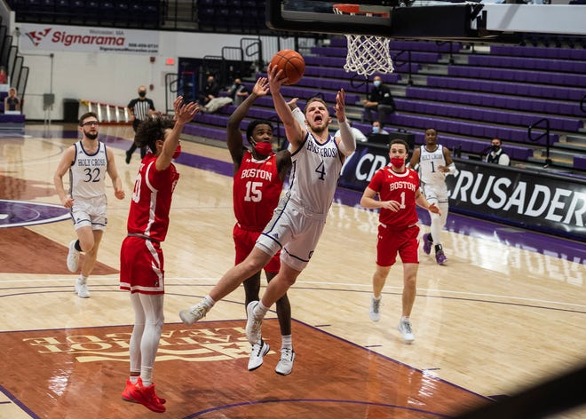 Austin Butler sparked the Holy Cross men's basketball team past Boston University with a 30-point effort.
