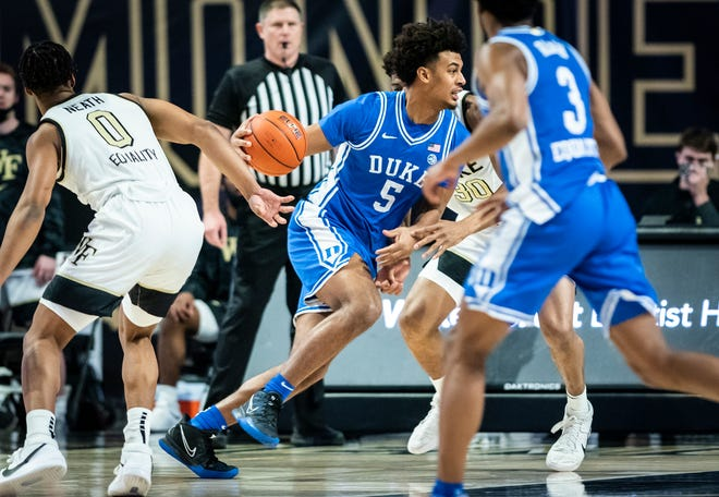 Duke forward Jaemyn Brakefield (5) drives to the basket on Wednesday, Feb. 17, 2021 in Winston-Salem, N.C. (Winston-Salem Journal/Andrew Dye) 021821-wsj-spt-wakeasf