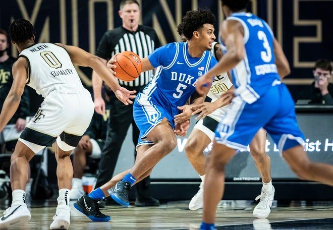 Duke forward Jaemyn Brakefield (5) drives to the basket on Wednesday, Feb. 17, 2021 in Winston-Salem, N.C. (Winston-Salem Journal/Andrew Dye) 021821-wsj-spt-wakeasf