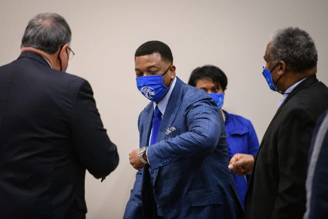 Darrell Allison, center, bumps elbows with trustee Warren McDonald, left, and trustee Glenn Adams at Fayetteville State University on Thursday, Feb. 18, 2021. Allison was introduced as the new chancellor.