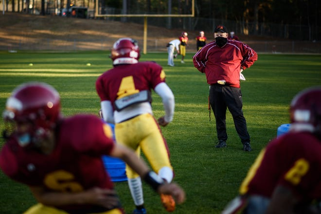 Coach David Watson watches over his players during practice this week at Douglas Byrd.