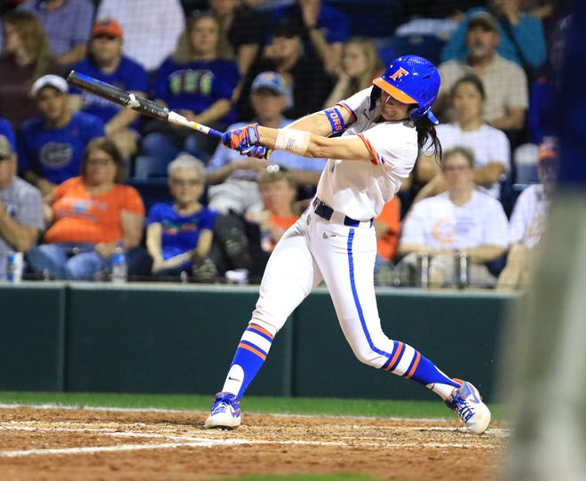 Florida second baseman Hannah Adams brings home Cheyenne Lindsey in the bottom of the seventh inning for the win over Jacksonville.