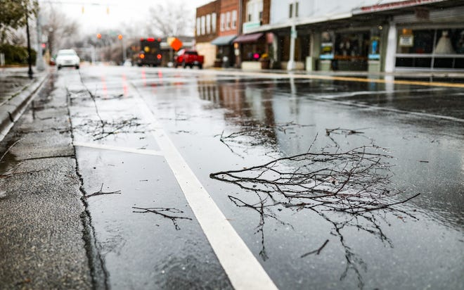 Minor branches were down in downtown Burlington on Thursday morning following the ice storm that occurred earlier in the morning.