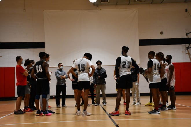 The Burlington School boys' basketball team huddles together at the conclusion of Tuesday evening's practice.