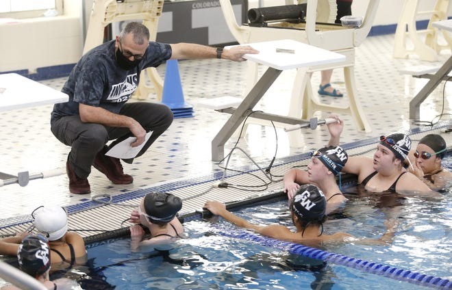 Canal Winchester swimming coach Shawn Elizondo talks with his team Jan. 23 at Westerville Community Center. Elizondo announced Feb. 18 that he was stepping down.