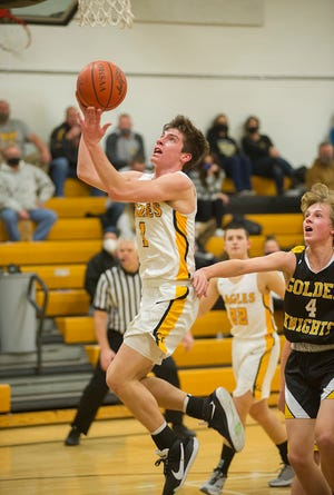 Colonel Crawford's Mason Studer soars to the basket for a layup.