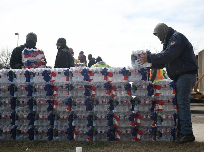 Bottled water is stacked up moments before they are delivered to seniors on Thursday, Feb. 18, 2021 as part of Corpus Christi's Meals on Wheels program.