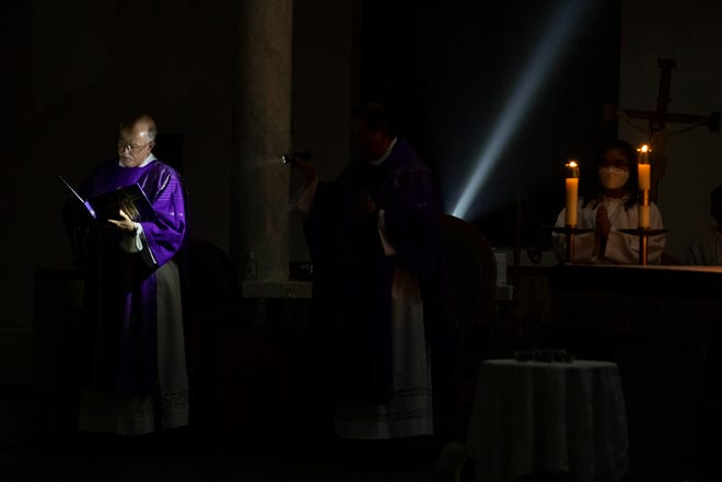 St. Philip the Apostle Church holds an evening Ash Wednesday service by candlelight on Wednesday, Feb. 17, 2021. St. Philip the Apostle had lost power due to severe winter weather earlier in the week.