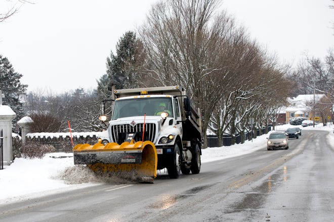 A snowplow clears snow on Rapid Run Road in West Price Hill on Thursday, Feb. 18, 2021. The National Weather Service issued a Winter Weather Advisory effective until 1 a.m. Friday.