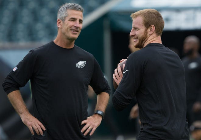 Philadelphia Eagles quarterback Carson Wentz and offensive coordinator Frank Reich (left) prior to a game against the New York Jets at Lincoln Financial Field on Sept. 1, 2016.
