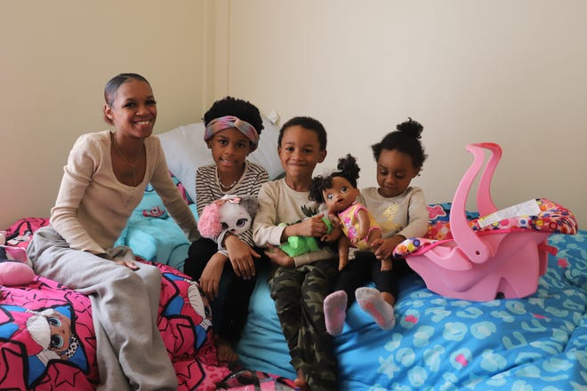 From left, Danielle Stallworth with her children, Jewels, Zion and Korri.