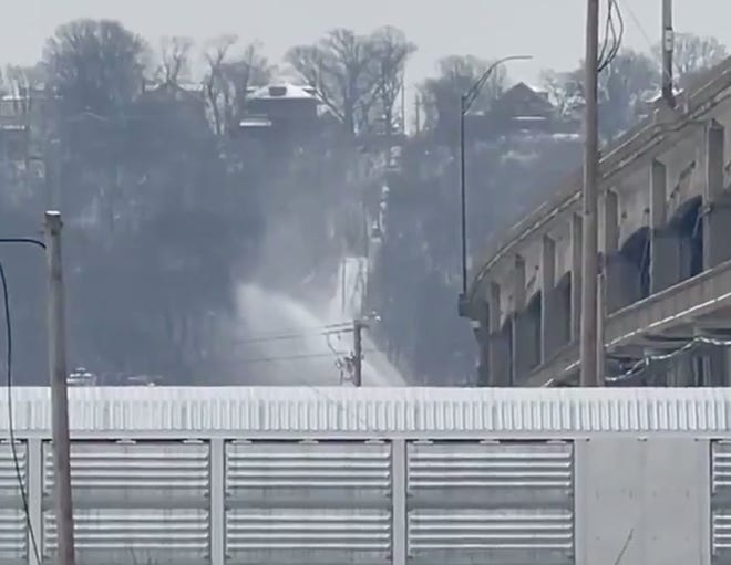 A water main break is spraying the Western Hills Viaduct causing icy conditions Thursday morning.