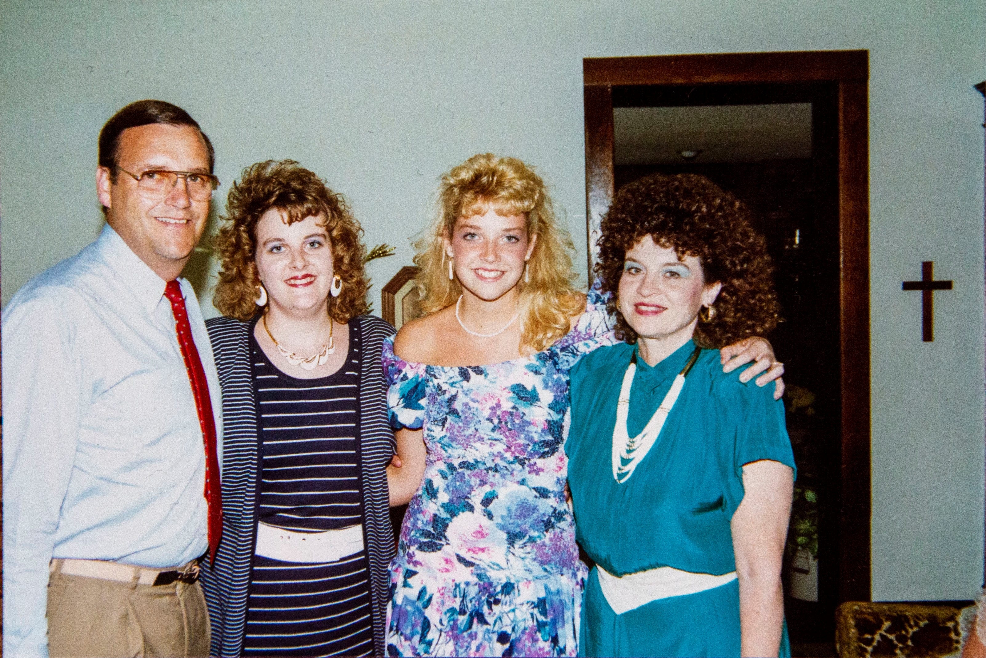 Suzanne Winkelpleck shares old family photos of her father, Lou Luiken, at her home of Feb. 11, 2021. From left are Lou, his daughters Jennifer and Suzanne, and his wife, Patty.