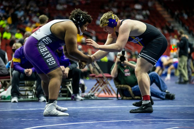 Burlington's Julius Harris wrestles Waukee's Ben Reiland at 285 in Class 3A during the first round of the Iowa High School State Wrestling Tournament on Thursday, Feb. 18, 2021, at Wells Fargo Arena, in Des Moines.