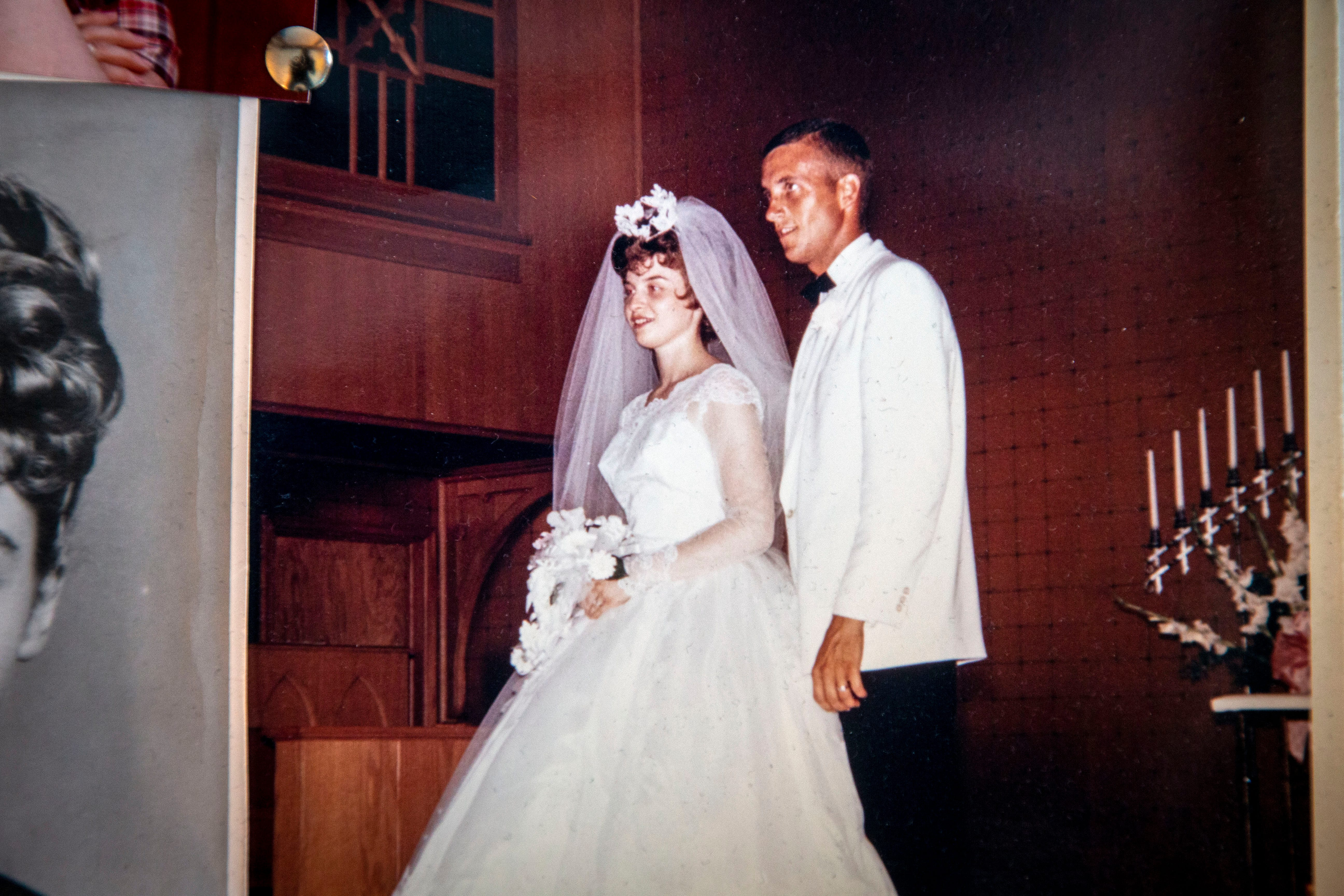A wedding photo of Lou and Patty Luiken is pinned on a cork board that Lou kept in his room before his death.