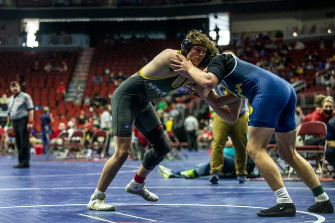 Ronan Poynton, of Iowa City Regina, wrestles Currey Jacobs, of New London, at 195, during the first round of the Iowa High School State Wrestling Tournament on Thursday, Feb. 18, 2021, at Wells Fargo Arena, in Des Moines.