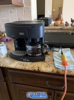 Randy Jones, a retired refinery worker from Caty, Texas and theownerof a 2021 F-150 PowerBoost Hybrid truck, used the truck generator to power his coffee maker during a blackout from February 14-17. This photo was taken Monday, February 15, 2021.