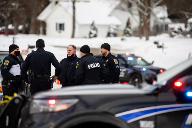 """Portage police investigate a missing persons case in Portage, Mich. on Tuesday, Feb. 9, 2021. Police checking on a Kalamazoo-area man who didn't report to work online put yellow tape around the property. Officers also brought shovels to the backyard. Gary and Laura Johnson, both in their mid-60s, were not at their Portage home, but officers found """"signs of violence."""" Public Safety Director Nick Armold says there's no """"rational explanation"""" for their disappearance."""