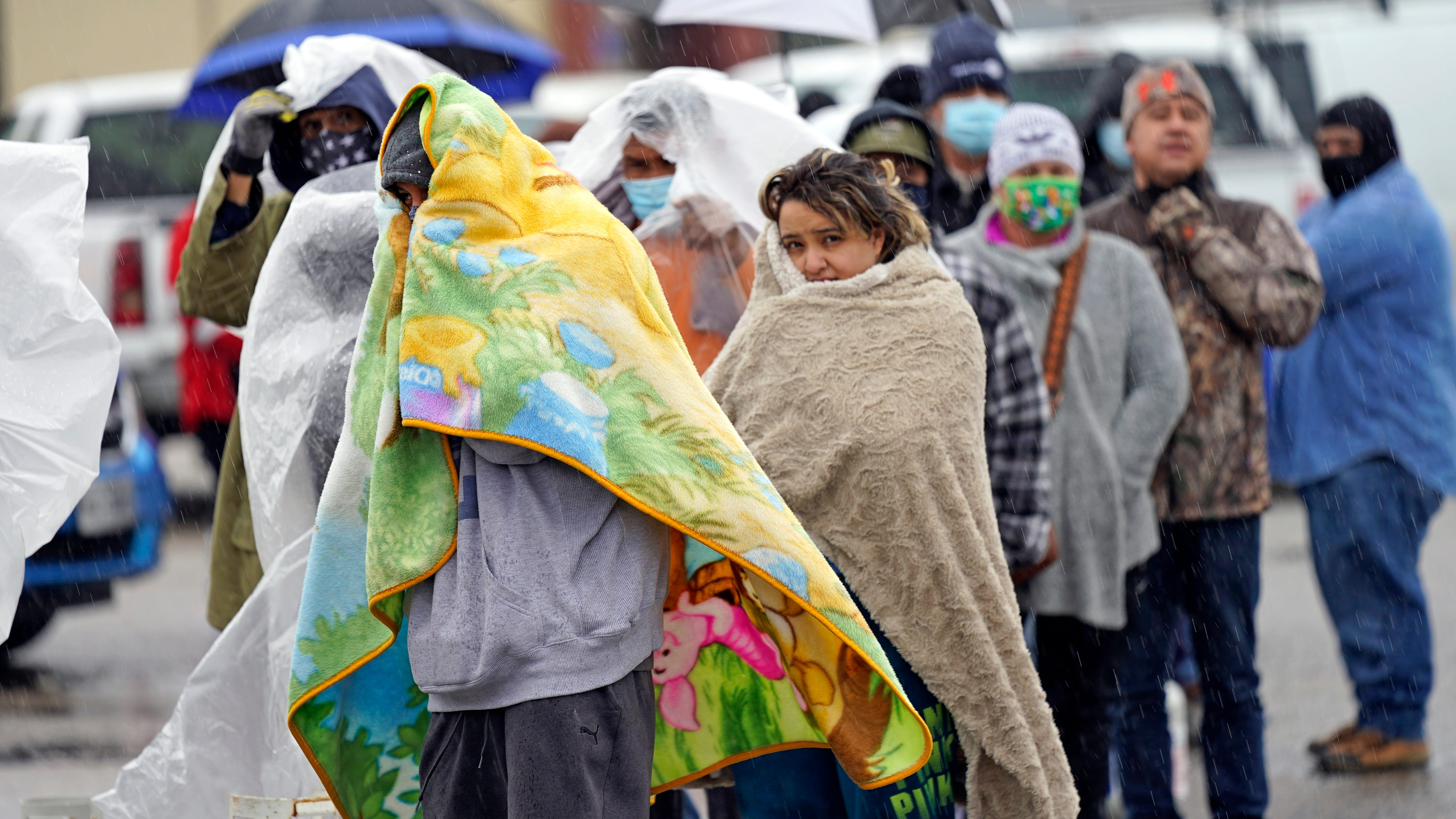 People wait in line to fill propane tanks Wednesday in Houston. Customers waited over an hour in the freezing rain to fill their tanks