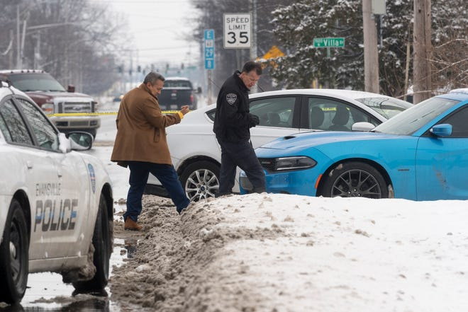 Evansville Police investigate the scene of a shooting at the intersection of Morgan and Ruston avenues in Evansville, Ind., Thursday morning, Feb. 18, 2021. Police said one of their detectives shot a man who was trying to run him over during a stolen vehicle investigation.