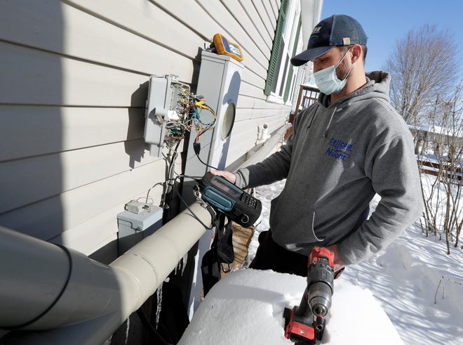 Craig Wallace, outside plant technician with Nsight, works on an internet installation  in rural Oconto County just north of Pulaski.