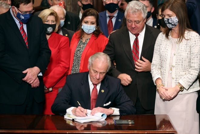 South Carolina Gov. Henry McMaster signs into law a bill banning almost all abortions in the state Thursday in Columbia.