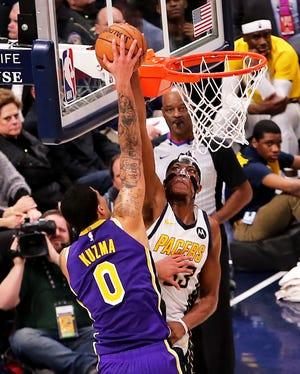 Myles Turner blocks Kyle Kuzma during a Pacers-Lakers game.